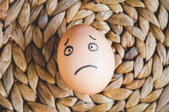 Concept human relationships and emotions eggs - sadness Royalty Free Stock Photos