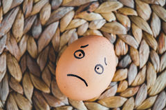 Concept human relationships and emotions eggs - sadness Stock Photo
