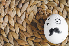 Concept human relationships and emotions eggs - wink Royalty Free Stock Image