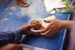 The Concept of Hunger Hunger : Sharing food with people in poor communities : The concept of feeding.  royalty free stock photos