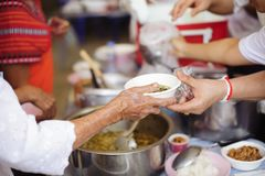 The Concept of Hunger Hunger : Sharing food with people in poor communities : The concept of feeding.  stock image