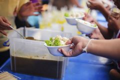 The Concept of Hunger Hunger : Sharing food with people in poor communities : The concept of feeding.  royalty free stock image