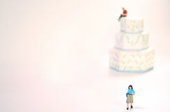 Concept: I'm Leaving You. Concept: Representation of divorce or separation. A woman is leaving her man. She is walking away from their wedding cake which Stock Illustration