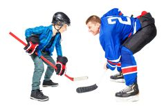 Concept ice hockey game players isolated on white. Background. Man and boy playing game Royalty Free Stock Photo