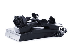 The concept idea is bad news. Sad message, sadness and sorrow. The concept idea is bad news. Sad message, the mood of melancholy, sadness and sorrow. Black rose Stock Image