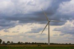 Concept idea eco power energy. wind turbine on hill with sunset stock photos