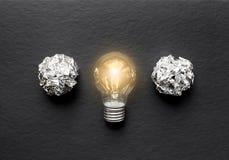 Concept of idea illustration lit lamp on black background Stock Image