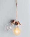 Concept of idea illustration lit lamp on gray background Stock Photo