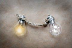 Concept of idea illustration lit lamp on kraft paper background Stock Images