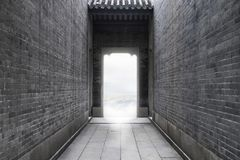 Concept idea image -path to success of light for freedom to success at the end of the vintage brick wall tunnel on outdoor texture stock image
