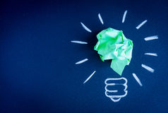 Concept idea inspiration with lamp dark background top view royalty free stock photo