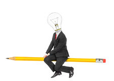 Concept of idea. Man in business suit with light bulb as head Stock Photography