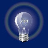 Concept ideas in the form of light bulb on a blue background. Royalty Free Stock Image