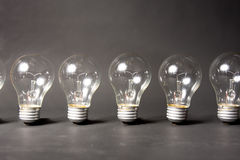 Concept of ideas with series of light bulbs Stock Photos