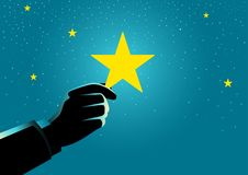 Businessman hand picking up a star Stock Photo