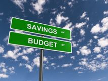 """Savings budget. A concept illustration with road signs for """"Savings Avenue"""" and """"Budget Street Royalty Free Stock Photos"""
