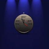 Concept illustration of timer with previous and future years. 3D rendering of grey stop watch with arrows showing 2017 year on blue isolated background with Royalty Free Stock Photos