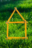 Concept image for building a house. A concept image for building a house on a greenfield Stock Photography