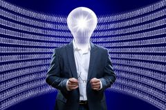Concept image of a business man IT engineer in front of zeros and ones Royalty Free Stock Photo