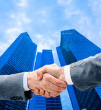Business people shaking hands over a deal Stock Photos