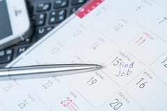 Concept image of a Calendar with a red push pin. Closeup shot of Stock Images