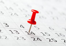 Concept image of a calendar with red push pins Royalty Free Stock Photo