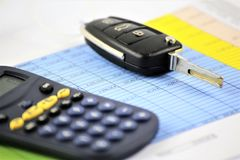 An concept Image of a car key, calculator and a Business paper stock photography