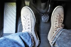 An concept image of a car pedal with jeans and foodware. An concept image of a car pedal, jeans - abstract Royalty Free Stock Photo
