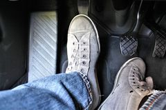 An concept image of a car pedal with jeans and foodware. An concept image of a car pedal, jeans - abstract Royalty Free Stock Image