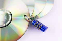 An concept Image of a cd and a lock - data security Stock Photos