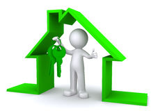 Concept image of a character holding a house key inside miniature house model Royalty Free Stock Images