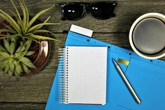 An concept Image of a colorful Folder with a Notebook a glasses and a coffee with copy space Royalty Free Stock Images