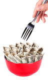 Concept image of food money. Red plate full of money and Chinese chopsticks isolated royalty free stock image