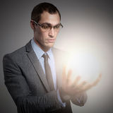Concept Image. Innovation. Businessman with light in his hands royalty free stock image