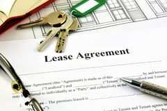 An concept Image of a Lease Agreement. With keys, pen and glasses Royalty Free Stock Photo
