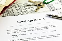 An concept Image of a Lease Agreement. With keys, pen and glasses Royalty Free Stock Photos