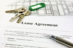 An concept Image of a Lease Agreement. With keys, pen and glasses Stock Image