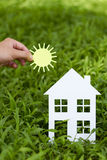 Concept image of make your a house. On green grass Royalty Free Stock Photo