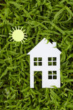 Concept image of make your a house. On green grass Stock Photography