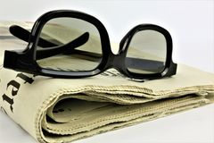An concept Image of a newspaper with glasses royalty free stock image