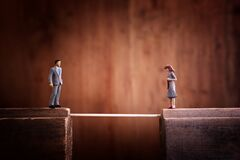 Free Concept Image Of Bridging The Gap. A Man Has To Cross A Thin Rope To Reach His Partner Who Is On The Other Side Royalty Free Stock Images - 195157959