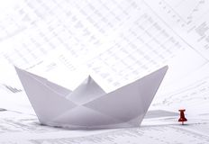 Concept image with a paper boat and documents Stock Image