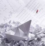Concept image with a paper boat and documents Royalty Free Stock Photos