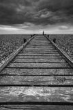 Concept image of path to nowhere in desolate beach black and whi Royalty Free Stock Photo