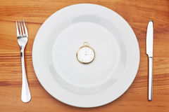 Concept image plate fork and pocket watches. Stock Image