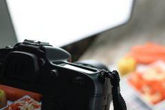 Food photography production. Concept image - rear view of DSLR camera making a food photography in the photo studio royalty free stock photo