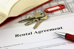 An concept Image of a rental agreement. With a book and keys Royalty Free Stock Images