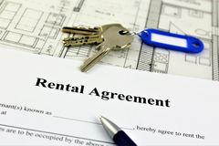 An concept Image of a rental agreement. With a book and keys Stock Image