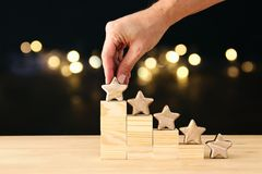 Concept image of setting a five star goal. increase rating or ranking, evaluation and classification idea. Concept image of setting a five star goal. increase royalty free stock image