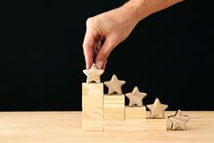 Concept image of setting a five star goal. increase rating or ranking, evaluation and classification idea. Concept image of setting a five star goal. increase stock photos